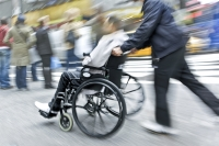 bigstock-handicapped-person-on-a-wheelc-17173505